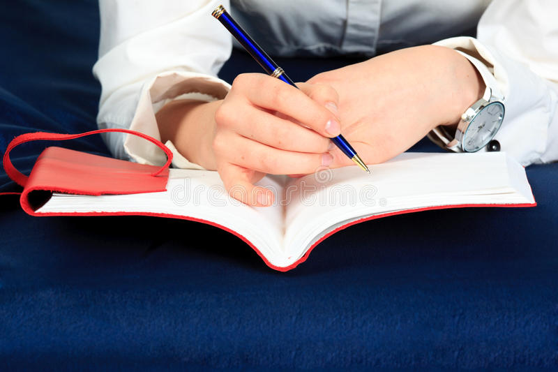 Hand and notebook. Close up royalty free stock photo