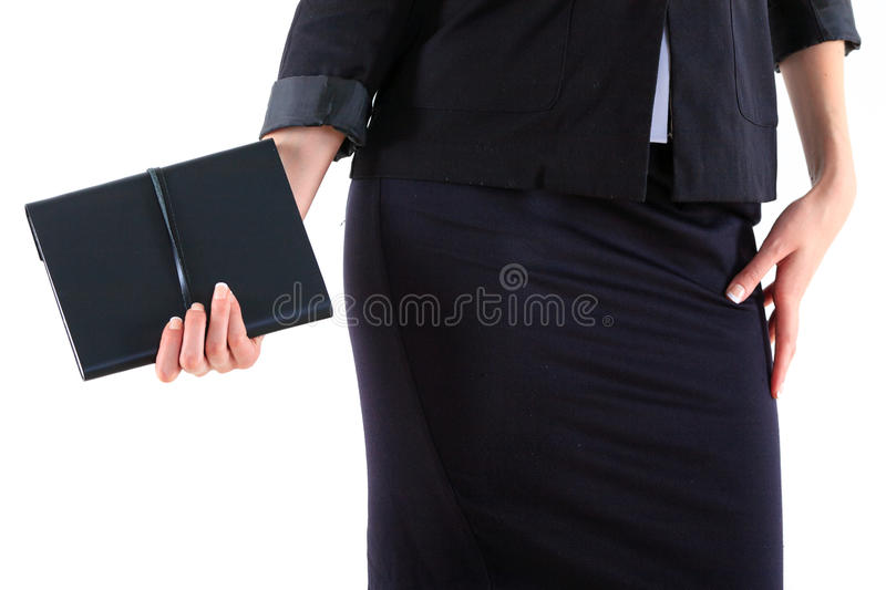 Hand and notebook. Close up royalty free stock photography