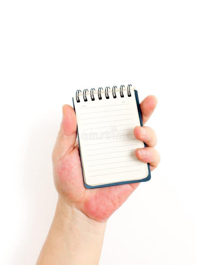 Hand och notepad arkivbilder