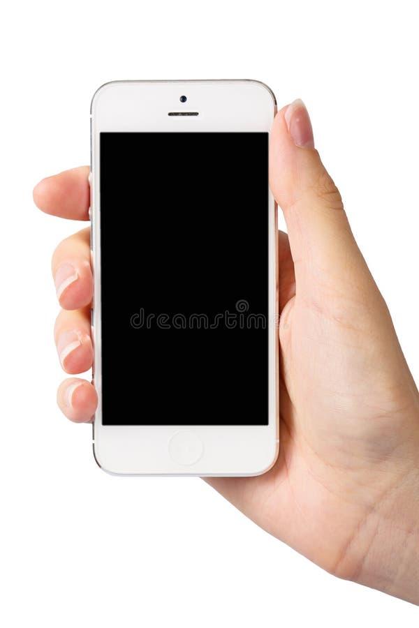 Hand och smartphone på vit bakgrund royaltyfria foton