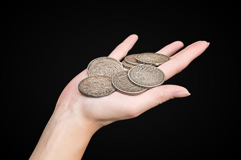 Hand with old coins isolated with clipping path royalty free stock photo