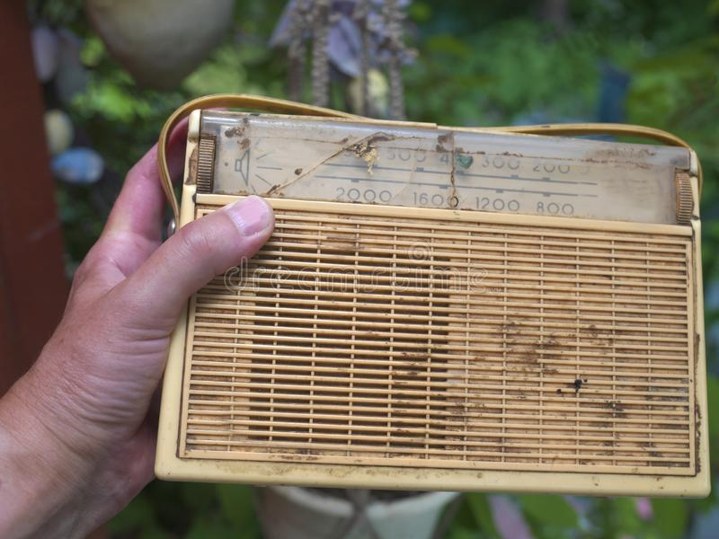 Hand with old radio stock images