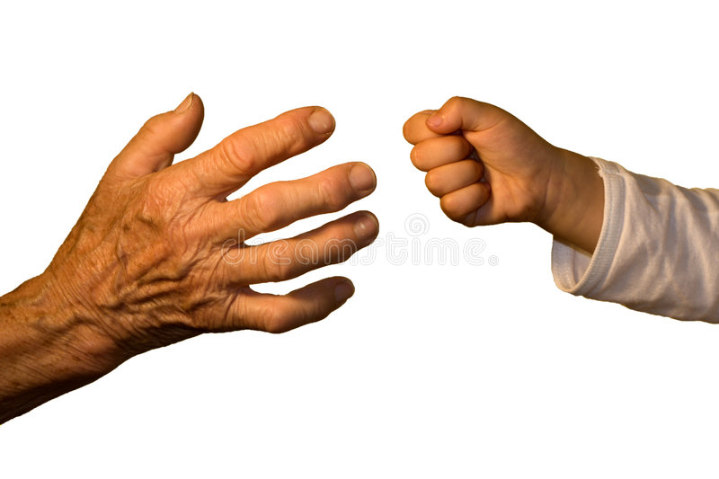 Hand of old woaman and child by game. Detail stock photo