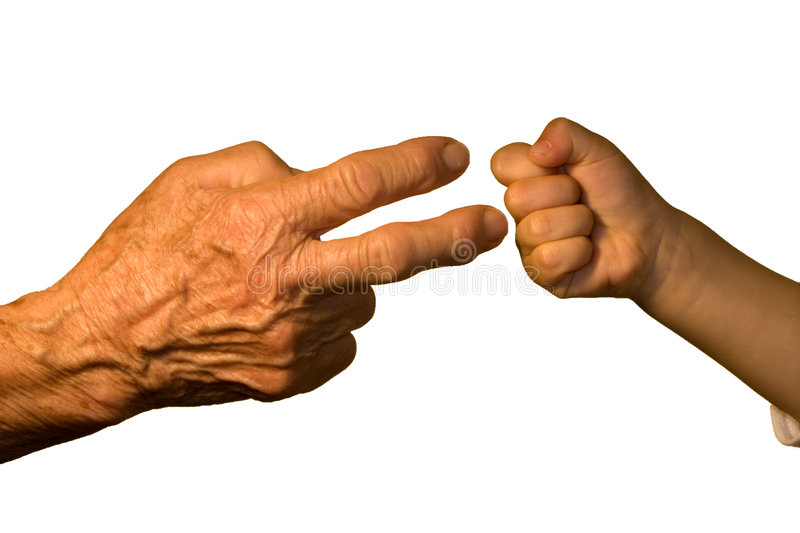 Hand of old woaman and child by game. Detail stock images