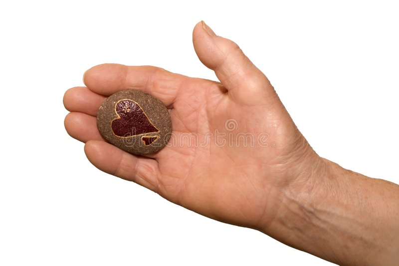 Hand of old woman with the heart. Detail stock images
