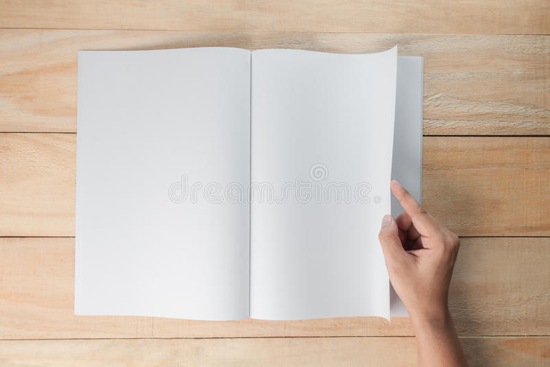 Hand open blank book or magazines stock photo