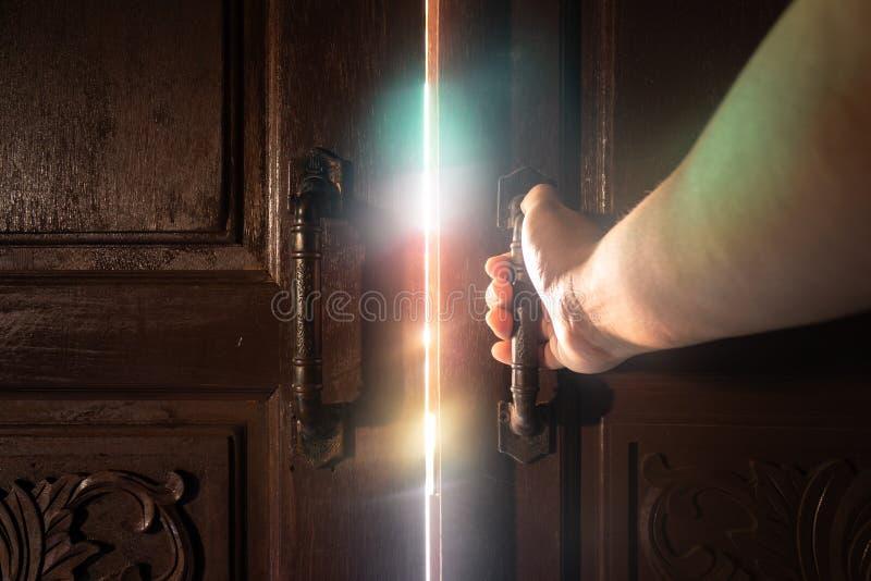 Hand open door light. royalty free stock photos