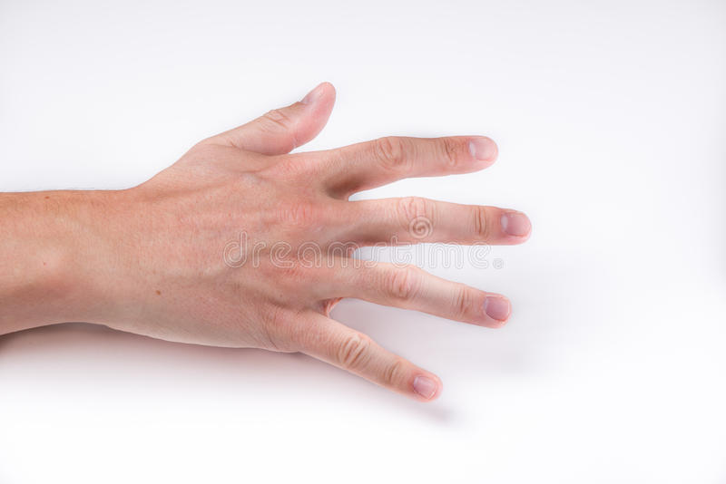 A hand with open fingers grabbing emptyness stock image