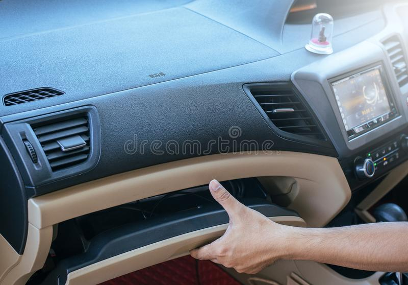 Hand man open glove compartment in car royalty free stock photography