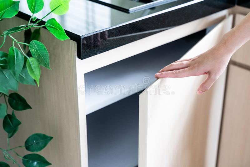 Hand Open Kitchen Cabinet. Close up hand Open Kitchen Cabinet stock photos