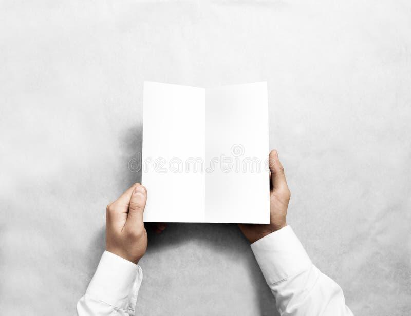 Hand opening blank white flyer brochure booklet mockup. Leaflet presentation. Pamphlet mock up holding hand. Man show clear offset paper. Booklet design stock images