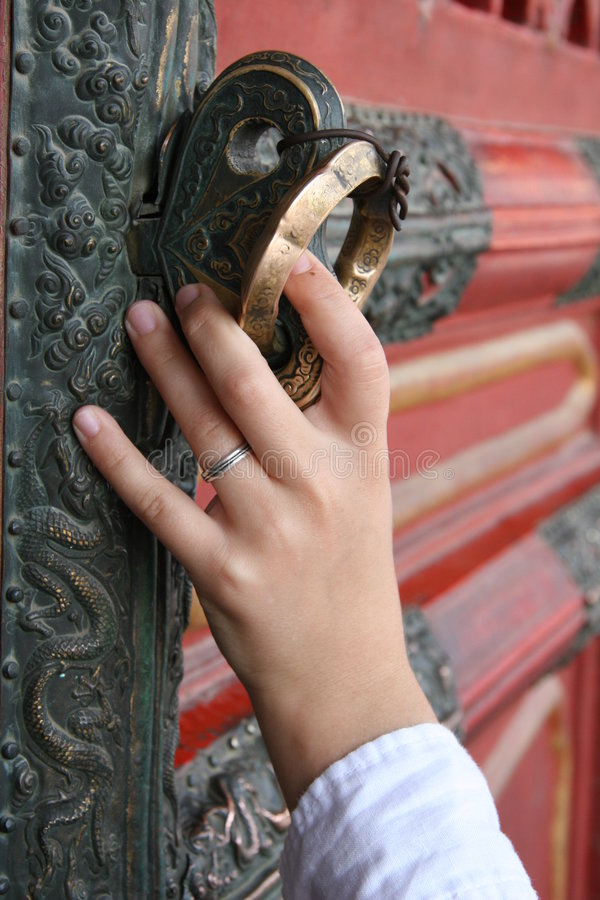 Hand Opening Fancy Chinese Door stock photography