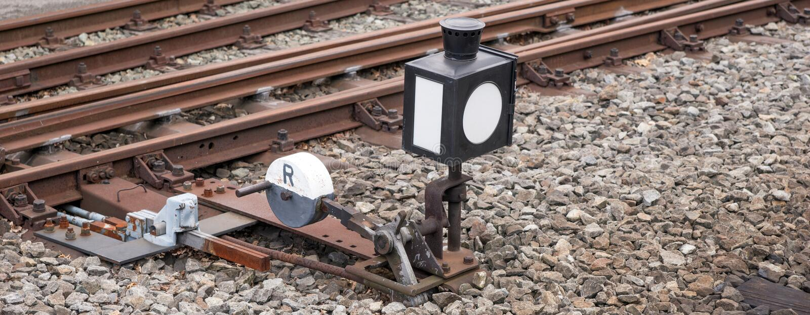 Hand-operated railroad switch with lever. Weight and signal stock photos