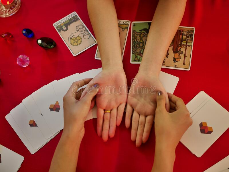 Hand out the customer at the fortune teller palm reading using Divine magic to forecast the future royalty free stock photography
