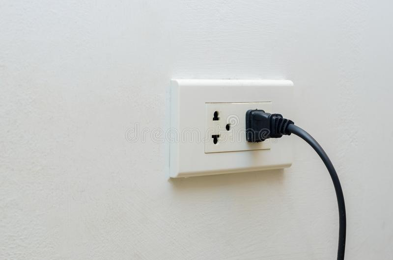 Hand outlet Power saving Hand inserting electrical plug into outlet royalty free stock photography