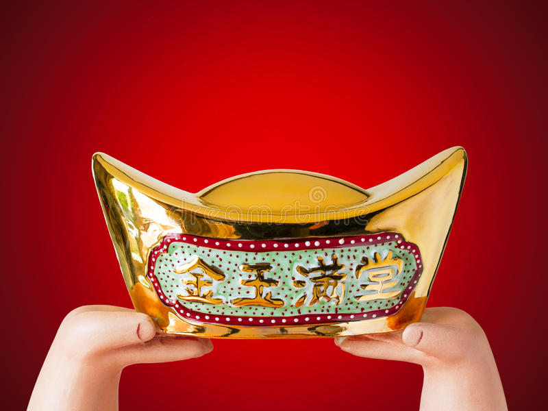 Hand over an antique Chinese golden money royalty free stock photos