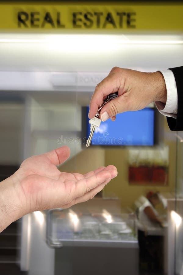 Hand Over Keys Stock Photography