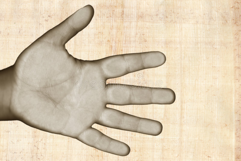 Hand over papyrus stock photo