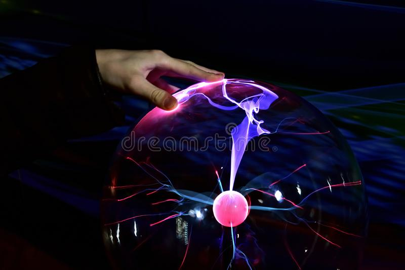 Hand over plasma lamp Tesla coil stock photography