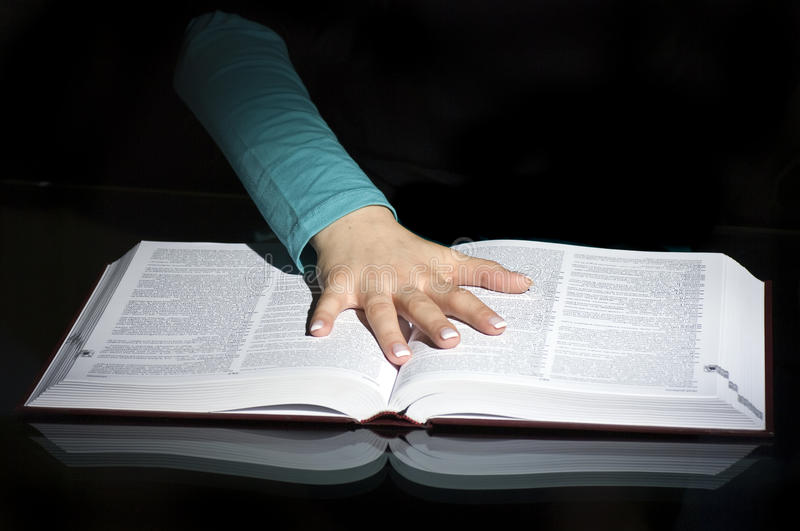 Download Hand on pages of open book stock image. Image of oath - 37182957