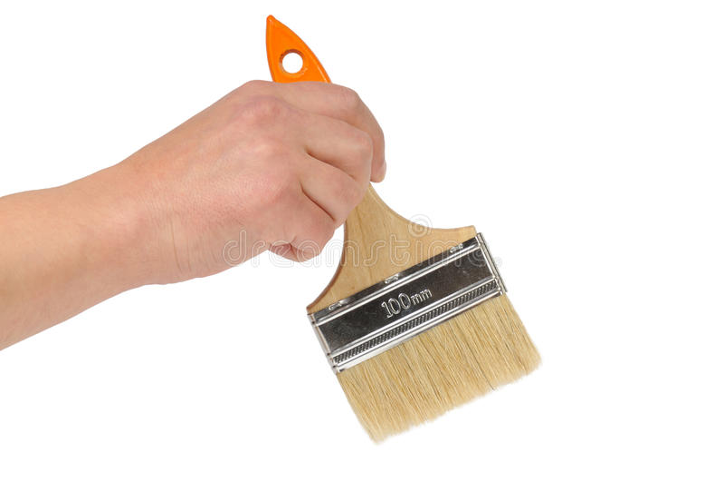Hand and paintbrush
