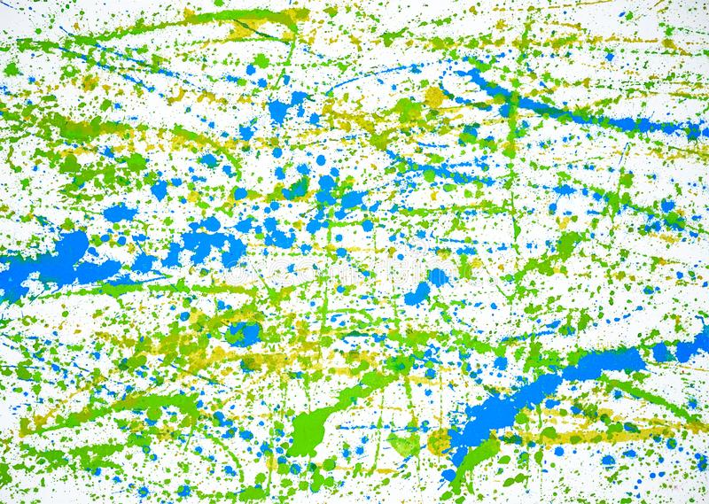 Hand painted abstract green, blue and yellow color splash on white paper. royalty free stock photo