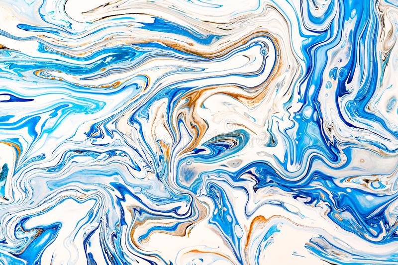 Hand painted background with mixed liquid blue, white, yellow paints. Abstract fluid acrylic painting. Applicable for. Hand painted background with mixed liquid royalty free stock photography