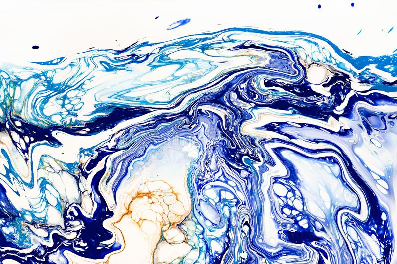 Hand painted background with mixed liquid blue, white, yellow paints. Abstract fluid acrylic painting. Applicable for. Hand painted background with mixed liquid stock photography