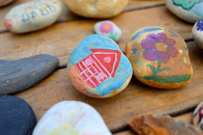 Hand painted beach pebbles royalty free stock image