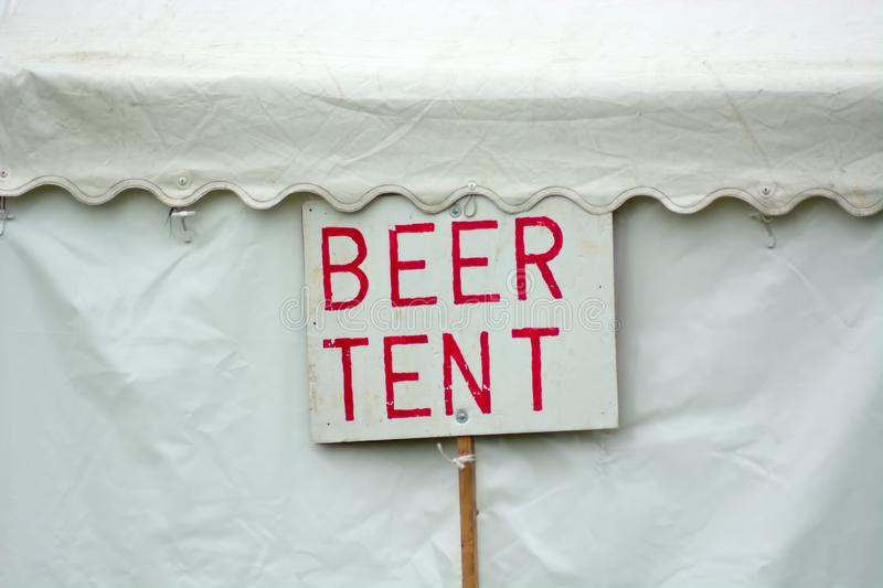 Hand painted beer tent sign. A simple hand painted sign outside a tent selling beer at an outdoor event stock photography