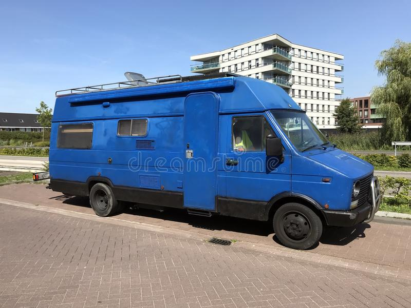 Hand painted Blue 1980`s Fiat camper van. Almere, the Netherlands - August 22, 2019: Hand painted Blue 1980`s Fiat camper van parked by the side of the road royalty free stock photography