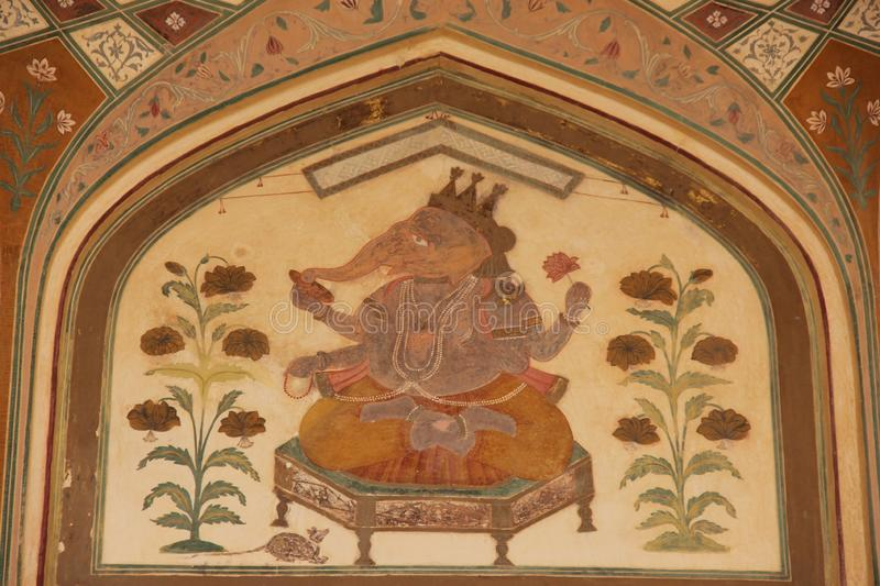 A hand painted detailed mural. Decorating the all of a old building in Jaisalmer, India stock image