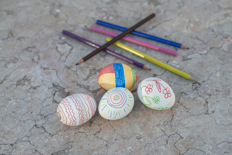 Hand painted Easter eggs on a Murble table stock photo