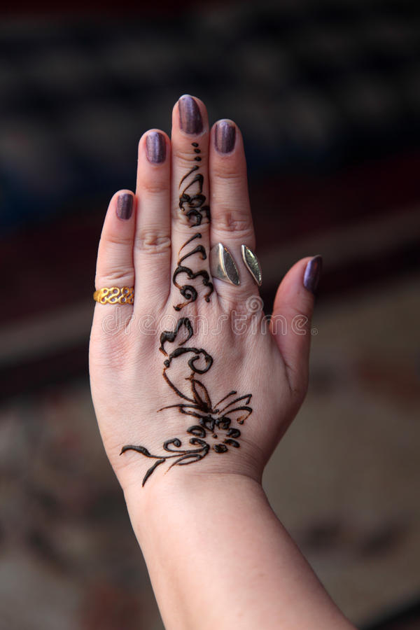 Hand painted with Henna stock photography