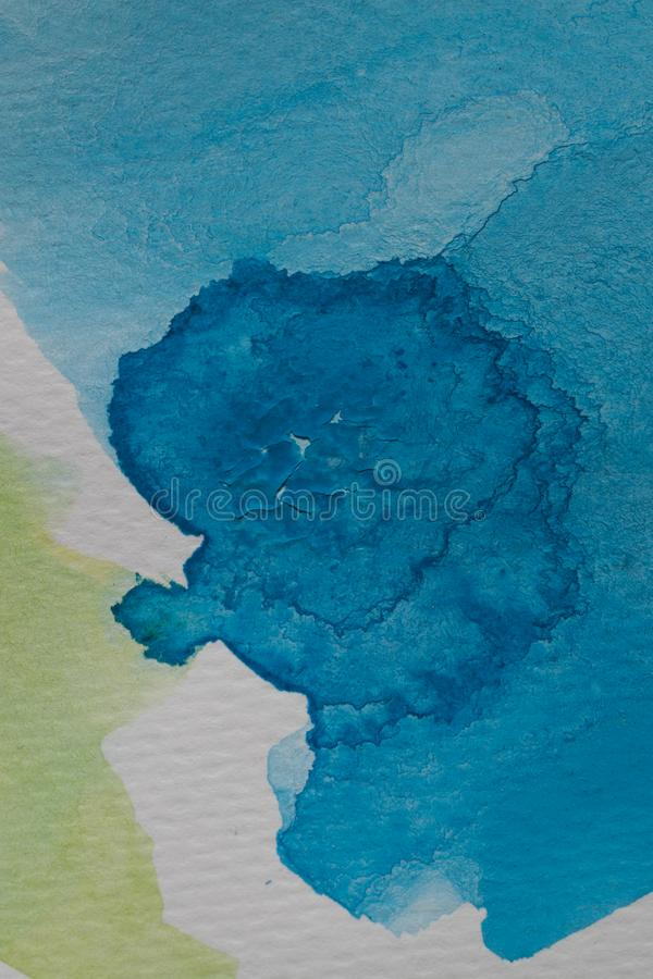 Hand painted watercolor background. Yellow and blue watercolor brush strokes on textured paper. Abstract texture and background for design royalty free stock photography