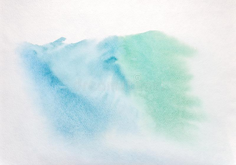 Hand painted watercolor wash background in blue and green colors stock image