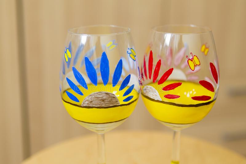 Hand painted wine glasses at a class for personal development stock images