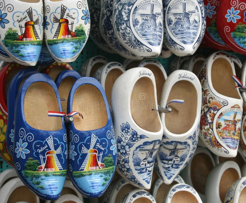 Original hand painted klompen (wooden shoes) with flags and mills, Amsterdam, Netherlands. Hand painted wooden shoes with Dutch national flags and windmills are stock images