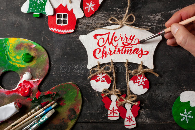 Hand painting Christmas decorations stock images