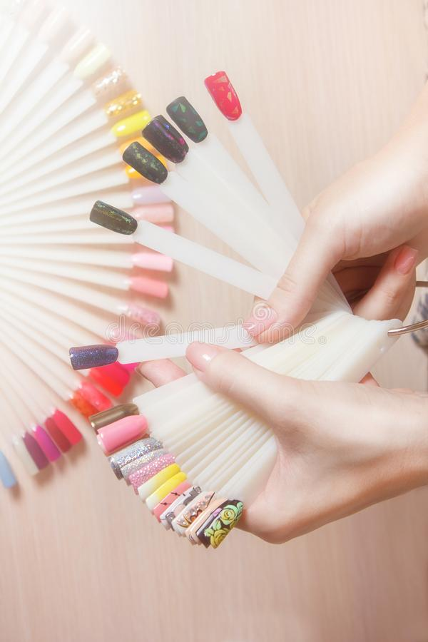 Top View Woman Choose Manicure Colorful Nail Polish. Nail Technician ...