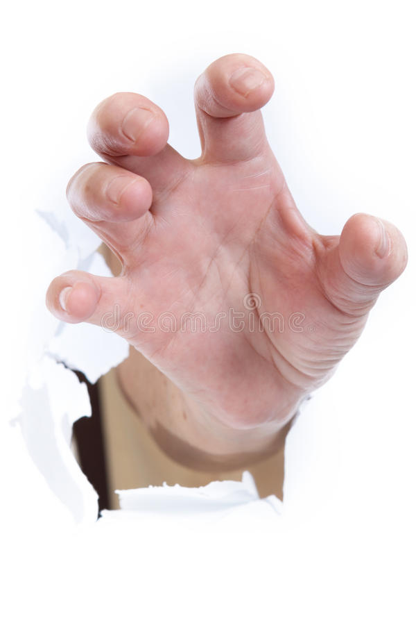 Hand through paper. Close up stock images