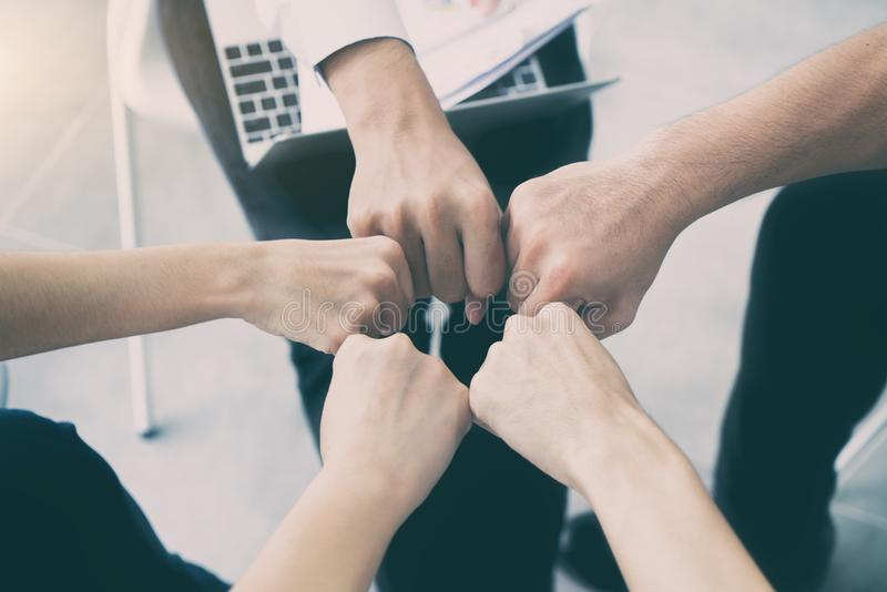 Hand partnership business team giving Fist Bump after complete d stock image
