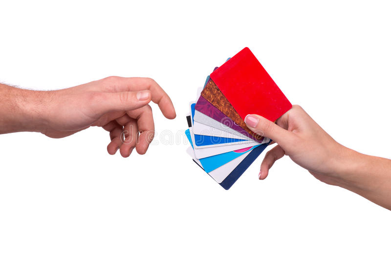Hand passing visiting cards to other person royalty free stock image