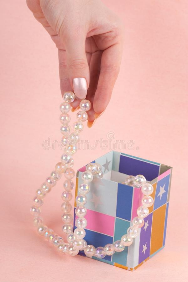 Download Hand with pearl beads stock photo. Image of pearl, bead - 14461962