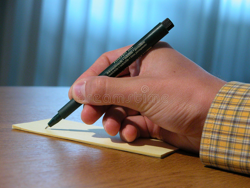 Hand and pen stock photos