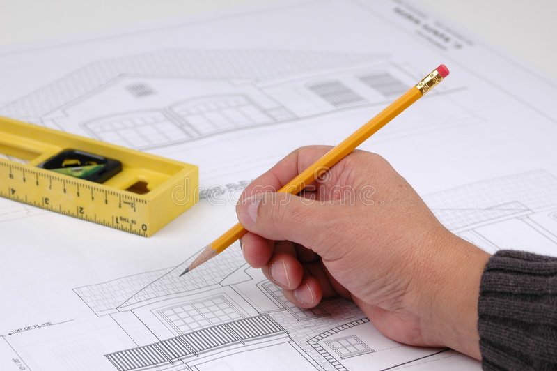 Hand and pencil on blue print royalty free stock photo