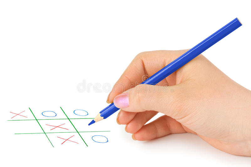 Hand with pencil and game. Isolated on white background royalty free stock photo
