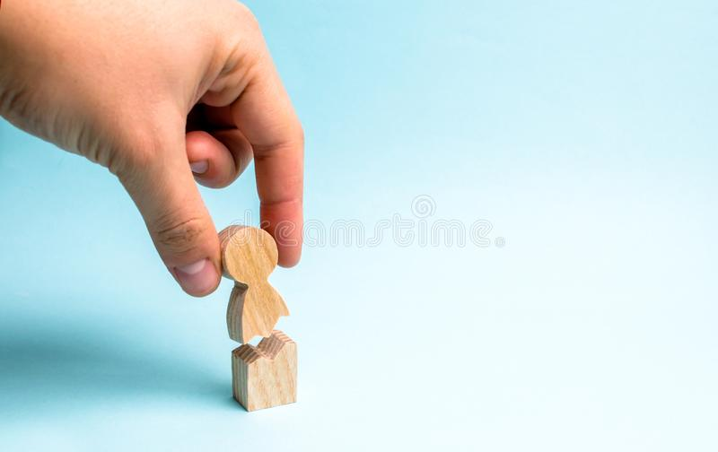 The hand of the person collects a figure of the person together. Psychological assistance and support. Treatment of psychological royalty free stock image