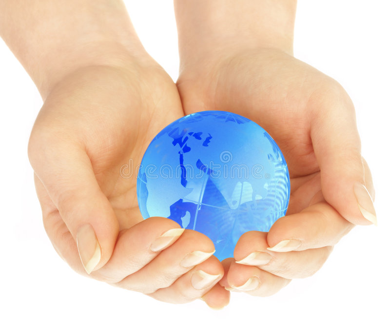 The hand of the person holds globe stock photos