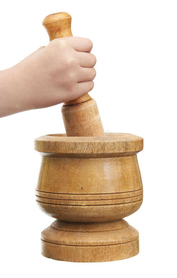Hand with Pestle and Mortar royalty free stock photo